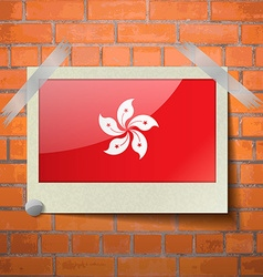 Flags Hong Kong scotch taped to a red brick wall vector