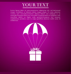 gift box flying on parachute on purple background vector image