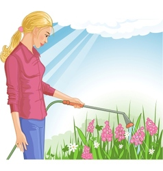 Young woman watering flowers in the garden vector