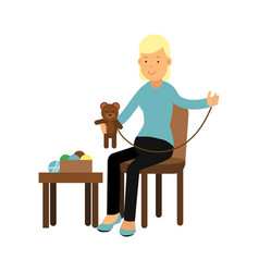 young woman sitting on the chair and sewing vector image vector image
