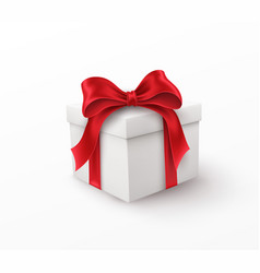 white gift box with red silk bow isolated vector image