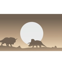 Silhouette of two triceratops dinosaur scenery vector