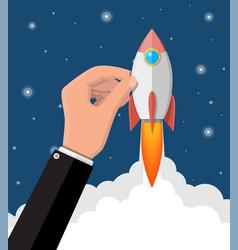 cartoon rocket in businessman hand vector image