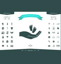 Hands holding baby foot vector
