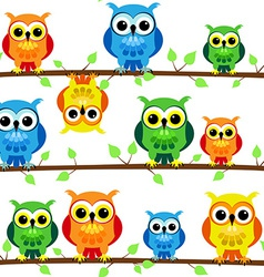Seamless owls on tree branch vector image
