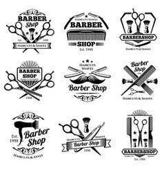 Vintage barbershop emblems and labels vector