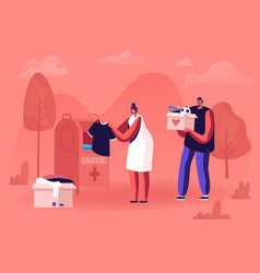 Man and woman volunteer sorting clothes and vector