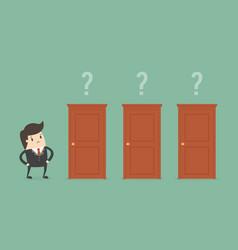 Businessman choosing the right door vector
