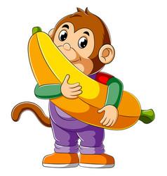 Cartoon monkey holding big banana vector