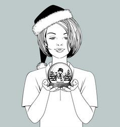 girl in santa hat holding a snow globe vector image