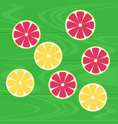 Lemons and grapefruits on green wood table vector