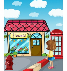 A small girl watching the flower shop vector