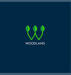 woodland logo with leaves vector image