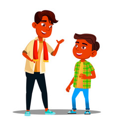 two indian boys talking to each other vector image