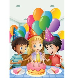 Three kids celebrating a birthday vector