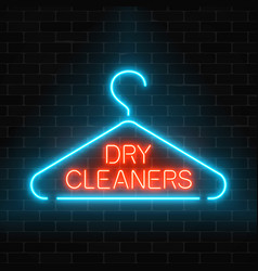 Neon dry cleaners glowing sign with hanger on a vector