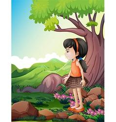A cute little girl near the giant tree vector