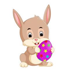 Cartoon little bunny holding easter egg vector