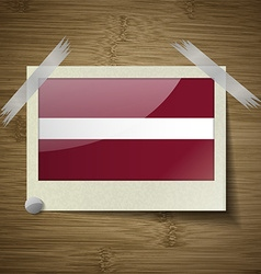 Flags Latvia at frame on wooden texture vector image