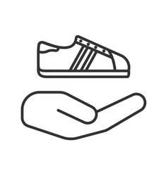 Open hand with sneaker linear icon vector