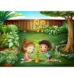 Two adorable kids studying the ladybug at the yard vector image