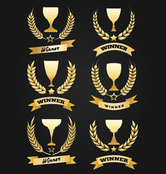 golden winner cups with ribbon vector image