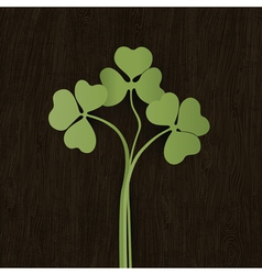 clover leaves on wooden weathered texture vector image