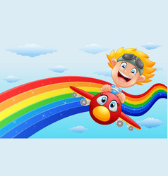 Happy little boy riding a plane in near rainbow vector