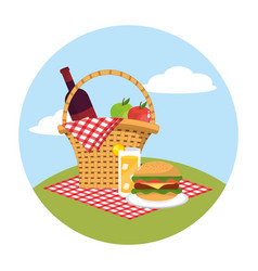 Basket with wine and apples in the tablecloth vector