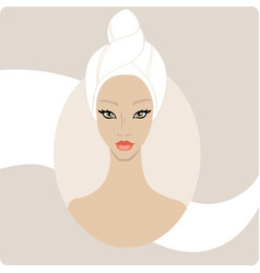 Beautiful woman keep hair wrapped in a towel spa vector