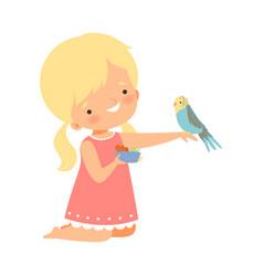 cute little blonde girl feeding her budgerigar vector image