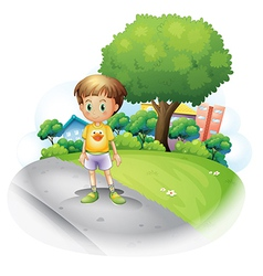 A little boy at the road across the high buildings vector