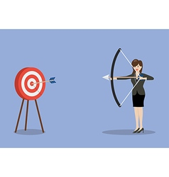 Business woman hitting the target vector