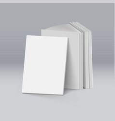 Stack of blank white books on deep background vector