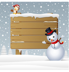 Cartoon snowman with a owl and a snowy wooden sign vector