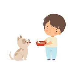 Cute little boy feeding his puppy adorable kid vector