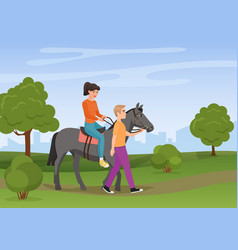 man leading the horse with the woman riding on it vector image