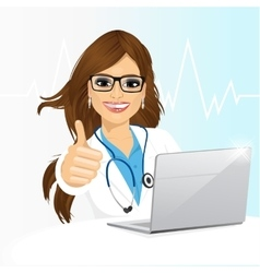 young female doctor using his laptop computer vector image