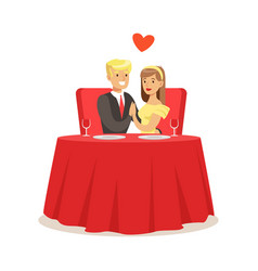 young elegant couple sitting at table in a cafe vector image vector image