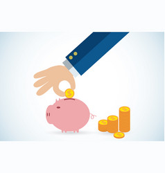 hand putting coin in piggy bank vector image
