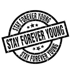 Stay forever young round grunge black stamp vector