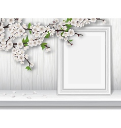 Spring blooming cherry branch and photo frame on a vector