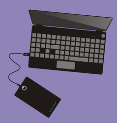 laptop connected to power bank top view vector image vector image