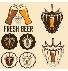 Set of beer labels with spikes and hop vector