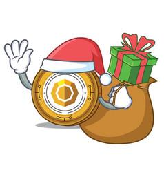 Santa with gift komodo coin mascot cartoon vector
