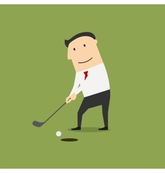 Businessman putting ball into a hole vector