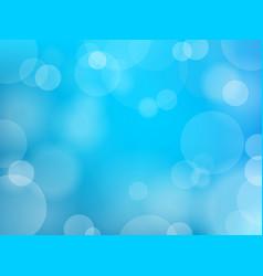 Bokeh effect blue background vector