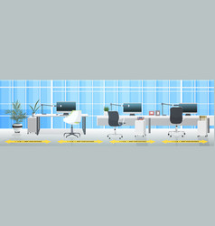 workplace desks with signs for social distancing vector image