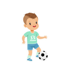 Cute little boy character kicking soccer ball vector