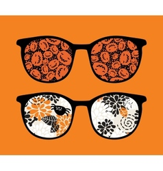 Retro sunglasses with pumpkins reflection in it vector